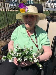Resident of Memory Care planting flowers