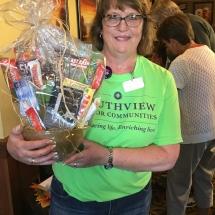 Alzheimers Fundraiser-Oak Park Senior Living-silent auction winner claiming their prize