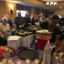 Alzheimers Fundraiser-Oak Park Senior Living-looking over the silent auction