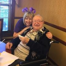 Alzheimers Fundraiser-Oak Park Senior Living-staff member hugging one of the tenants