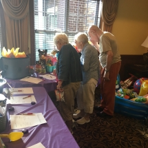 Alzheimers Fundraiser-Oak Park Senior Living-tenants checking out the silent auction