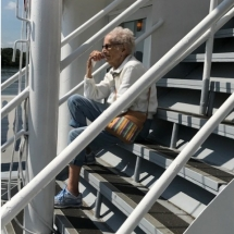 Stillwater Boat Ride-Oak Park Senior Living-tenant relaxing on the stairs