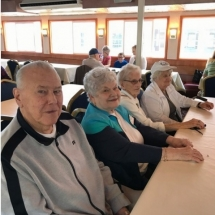 Stillwater Boat Ride-Oak Park Senior Living-group of our tenants socializing