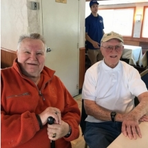Stillwater Boat Ride-Oak Park Senior Living-Men relaxing on the boat