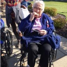 Bonfire in the Gazebo-Oak Park Senior Living-Snacking on a s'more