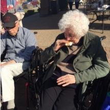 Bonfire in the Gazebo-Oak Park Senior Living-Crunching into a s'more